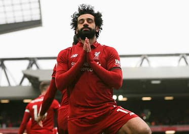 DraftKings UCL DFS Picks cheat sheet for daily fantasy soccer lineups on WEdnesday APril 14 with Mohamed Salah
