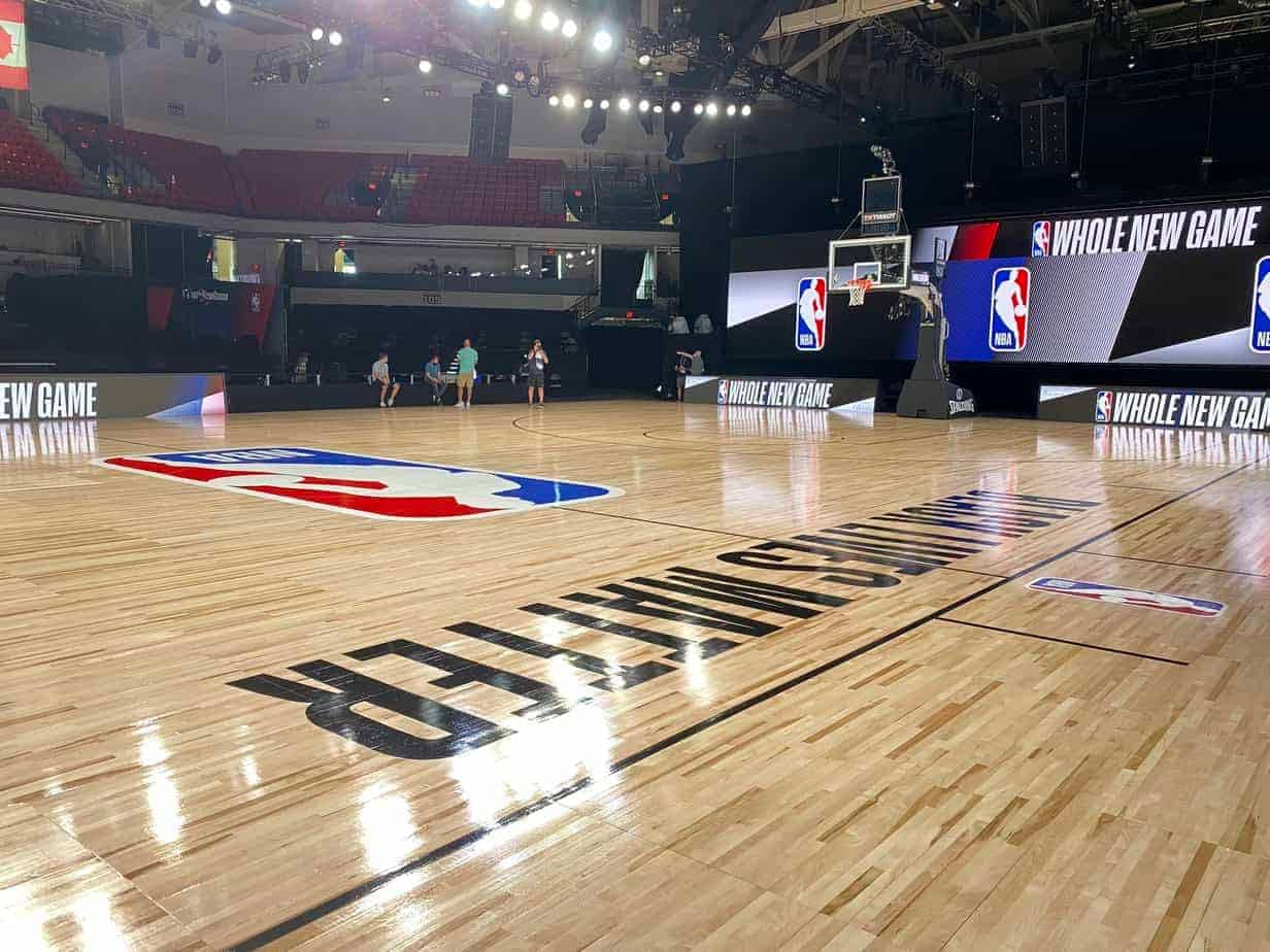 """Pictures of the NBA bubble TV broadcast courts have been released and they have """"Black Lives Matter"""" on them and socially distanced benches."""