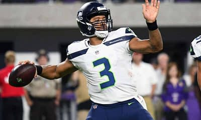 NFL DFS picks for Yahoo cheat sheet daily fantasy football wild card Saturday playoffs 2021 Russell Wilson Josh Allen expert projections and ownership