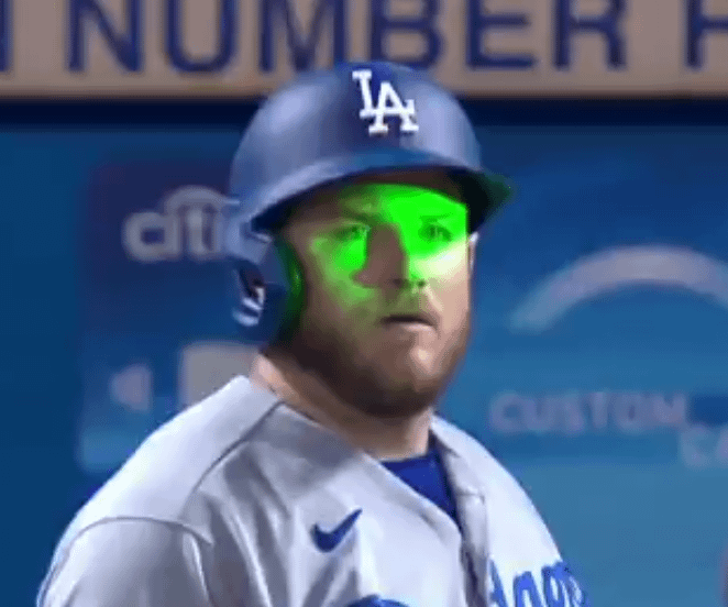 Max Muncy flashed with laser pointer