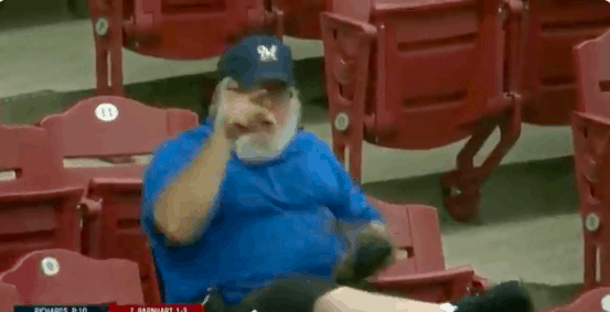 A Milwaukee Brewers fan is trending after tearing into a Reds fan who got in his way of catching a foul ball on Thursday