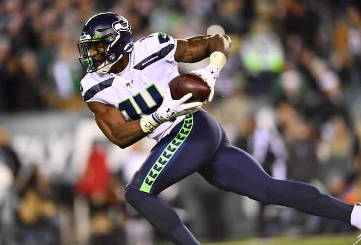 NFL betting picks for Wild Card Weekend Saturday Slate of games featuring expert prop bets on D.K. Metcalf Seahawks Rams Bills Colts Tampa Bay Buccaneers
