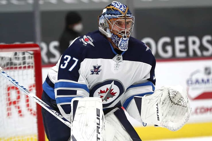 NHL Betting picks best bets today tonight odds lines predictions free expert Connor Hellebuyck Jets over/under moneyline parlay