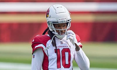 Deandre Hopkins Arizona Cardinals star receiver took to social media to reveal he's contemplating retirement due to NFL's rules against unvaccinated players