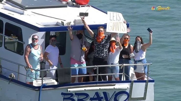 Hunter Pence was spotted spending his first official day of retirement on a boat in McCovey Cove, holding up a Let's Go Giants sign.